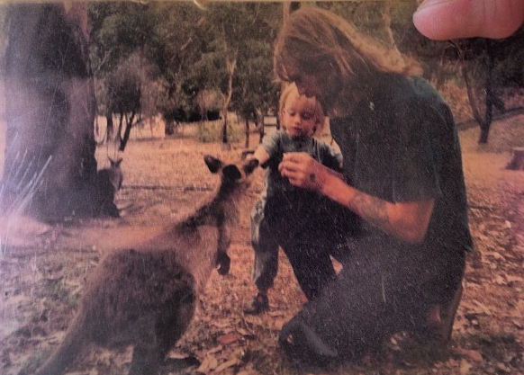 One of my favorite photos: me feeding a kangaroo as a child